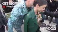 Miranda Kerr kiss attacked by prankster Vitalii Sediuk at Louis Vuitton Fashion Show in Paris