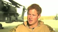 Prince Harry runs for an ice cream van during Afghanistan interview