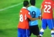 Suarez punch in the face Chile v Uruguay